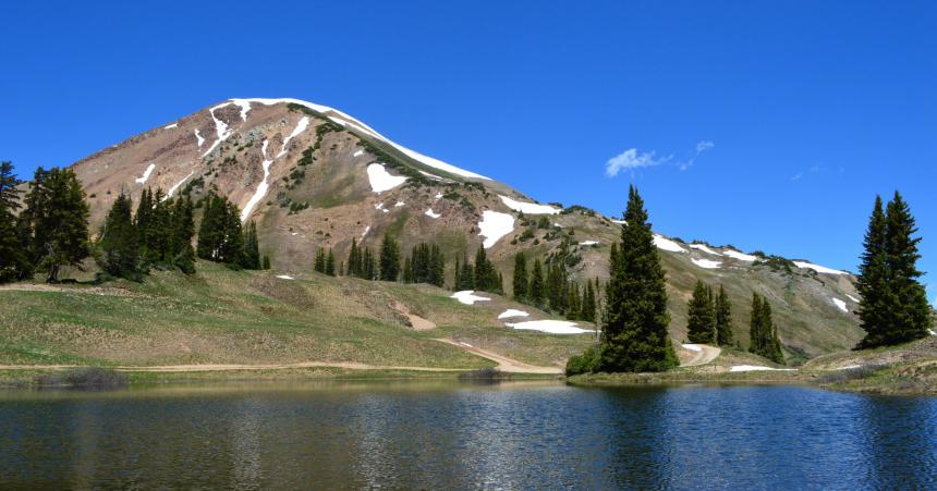 Image of rocky mountains in front of emerald lake